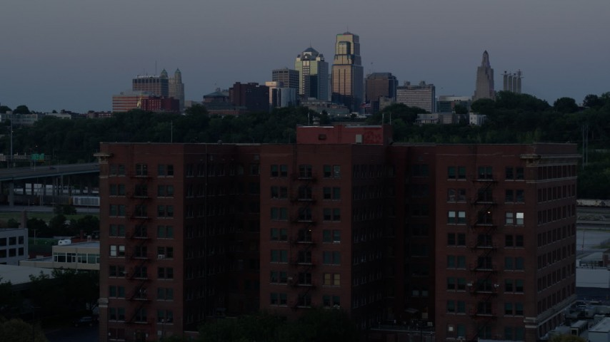 5.7K stock footage aerial video fly over brick building, approach skyline at twilight, Downtown Kansas City, Missouri Aerial Stock Footage | DX0001_001201
