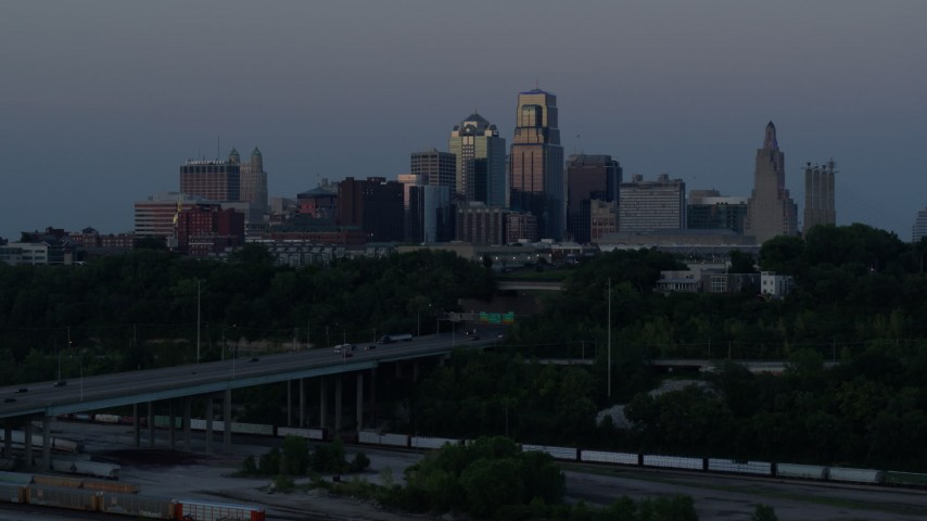 5.7K stock footage aerial video reverse view of the skyline at twilight, Downtown Kansas City, Missouri Aerial Stock Footage | DX0001_001202