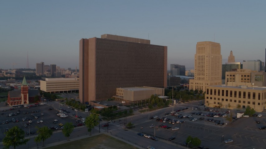 5.7K stock footage aerial video a reverse view of a government building at sunrise, Downtown Kansas City, Missouri Aerial Stock Footage | DX0001_001206