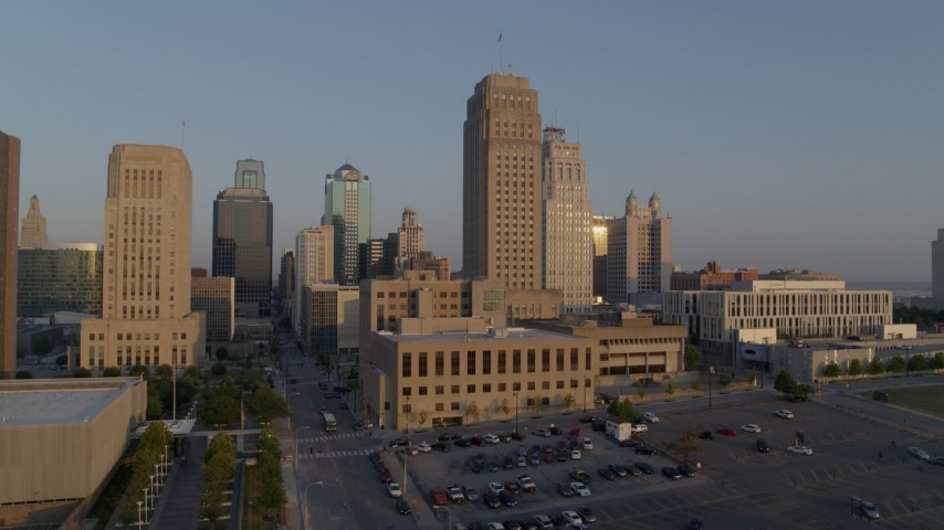 5.7K stock footage aerial video flyby city hall and skyscraper at sunrise, reveal office building, Downtown Kansas City, Missouri Aerial Stock Footage | DX0001_001209