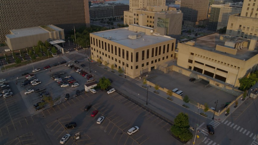 5.7K stock footage aerial video fly away from police station at sunrise, reveal government office building, Downtown Kansas City, Missouri Aerial Stock Footage | DX0001_001214