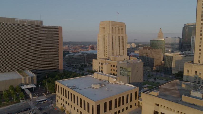 5.7K stock footage aerial video approach police station at sunrise, focus on courthouse, Downtown Kansas City, Missouri Aerial Stock Footage | DX0001_001215