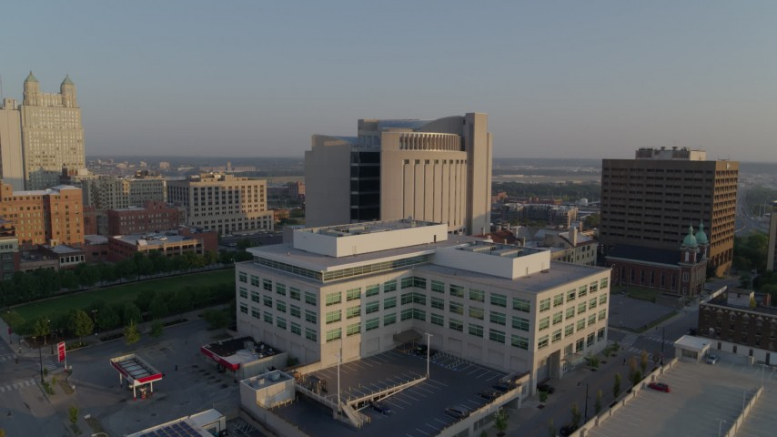 5.7K stock footage aerial video approach government offices at sunrise, focus on federal courthouse, Downtown Kansas City, Missouri Aerial Stock Footage | DX0001_001216