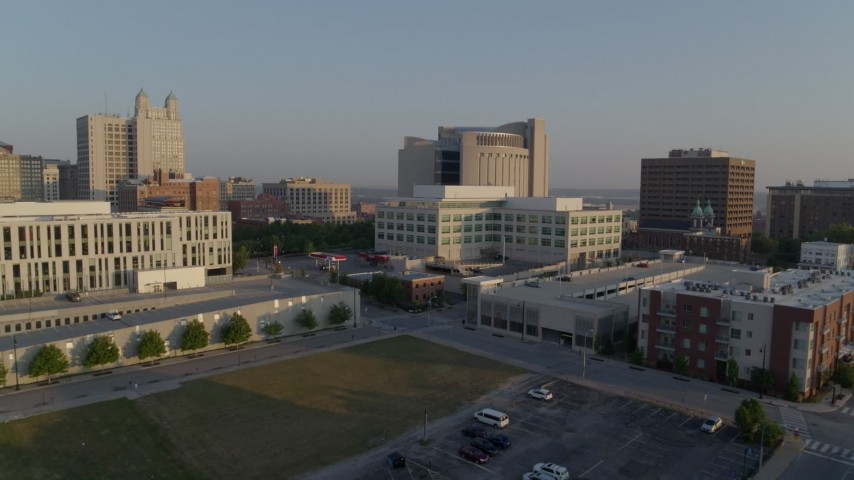 5.7K stock footage aerial video reverse view of federal courthouse and government offices at sunrise, Downtown Kansas City, Missouri Aerial Stock Footage | DX0001_001217