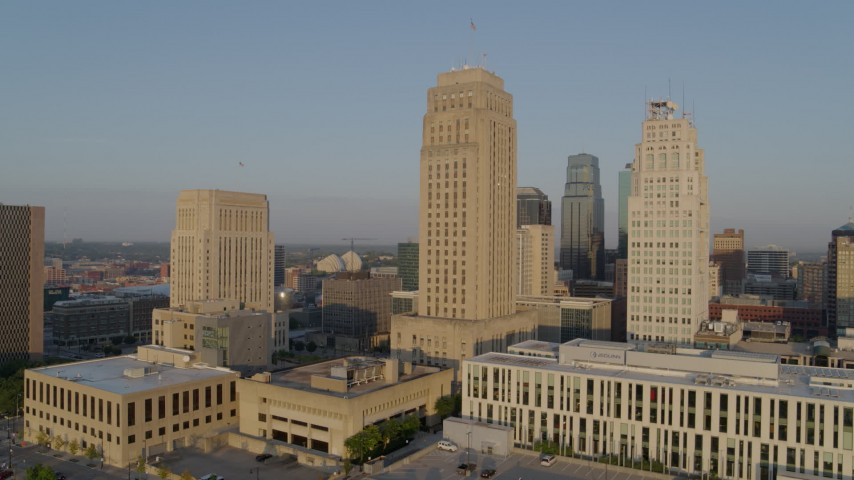 5.7K stock footage aerial video orbit city hall and neighboring skyscraper at sunrise, Downtown Kansas City, Missouri Aerial Stock Footage | DX0001_001221