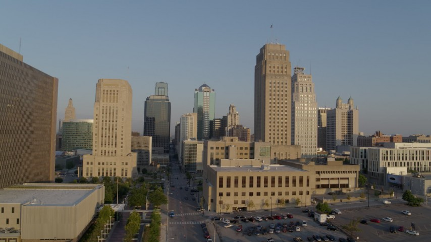 5.7K stock footage aerial video flyby city hall and neighboring skyscraper at sunrise, Downtown Kansas City, Missouri Aerial Stock Footage | DX0001_001222