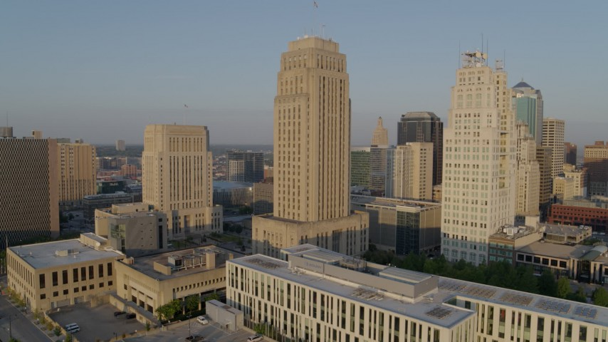 5.7K stock footage aerial video static view and flyby courthouse, city hall and neighboring skyscraper at sunrise, Downtown Kansas City, Missouri Aerial Stock Footage | DX0001_001225