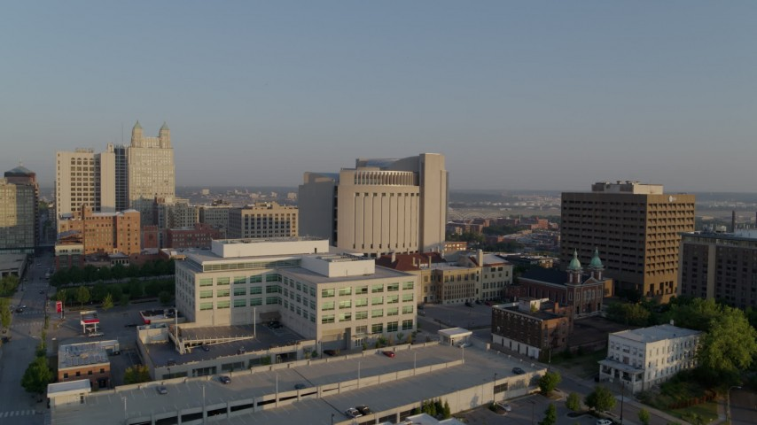 5.7K stock footage aerial video reverse view of government offices, federal courthouse at sunrise, Downtown Kansas City, Missouri Aerial Stock Footage   DX0001_001227