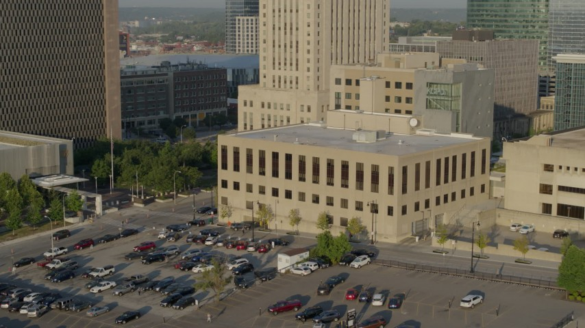 5.7K stock footage aerial video fly away from the downtown police station at sunrise, Downtown Kansas City, Missouri Aerial Stock Footage | DX0001_001240