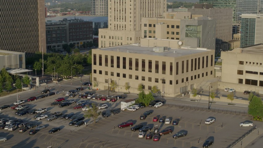 5.7K stock footage aerial video of passing the downtown police station at sunrise, Downtown Kansas City, Missouri Aerial Stock Footage | DX0001_001241
