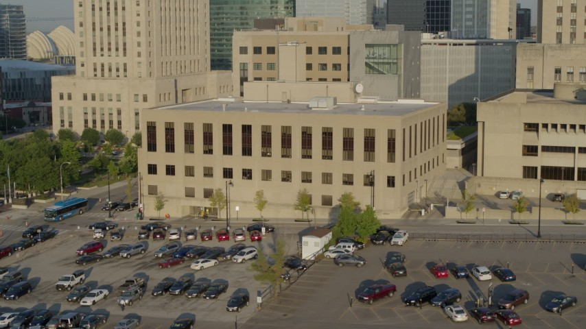 5.7K stock footage aerial video a static and reverse view of the downtown police station at sunrise, Downtown Kansas City, Missouri Aerial Stock Footage | DX0001_001242