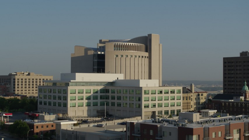 5.7K stock footage aerial video federal courthouse behind government office building at sunrise, Downtown Kansas City, Missouri Aerial Stock Footage | DX0001_001247