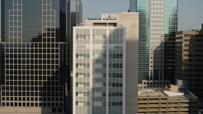 5.7K stock footage aerial video of orbiting a downtown office building at sunrise, Downtown Kansas City, Missouri Aerial Stock Footage | DX0001_001253