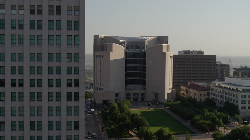5.7K stock footage aerial video flyby the federal courthouse for closer view of skyscraper at sunrise, Downtown Kansas City, Missouri Aerial Stock Footage | DX0001_001258