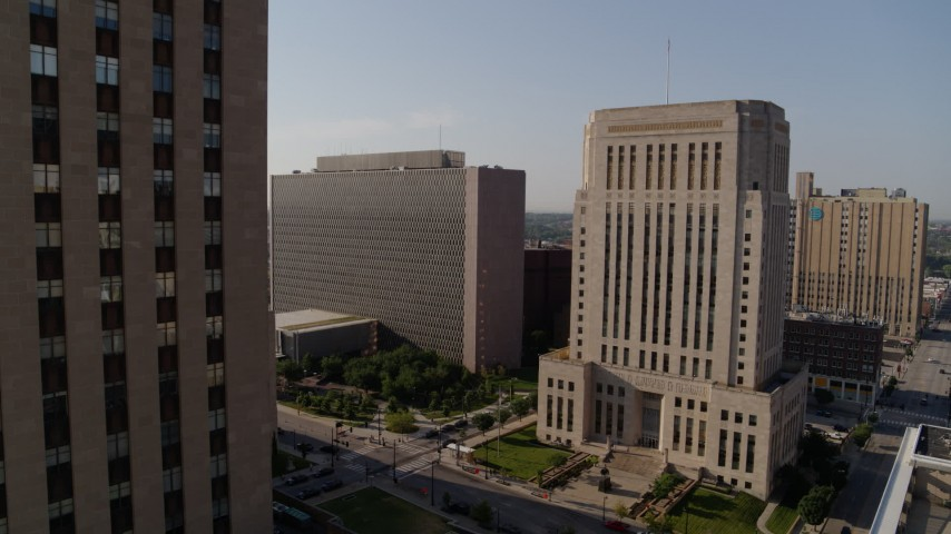5.7K stock footage aerial video of government office building beside a courthouse at sunrise, Downtown Kansas City, Missouri Aerial Stock Footage | DX0001_001261
