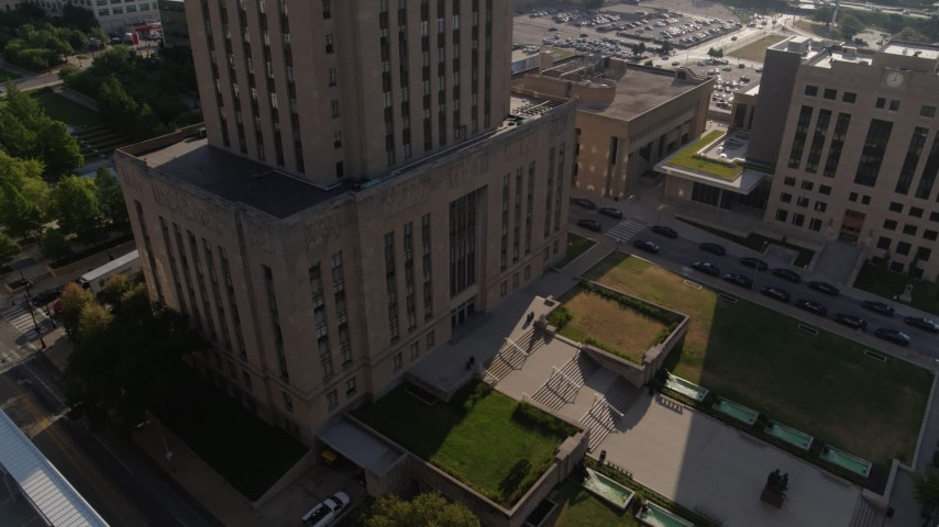 5.7K stock footage aerial video tilt from static view of city hall front steps at sunrise and orbit building, Downtown Kansas City, Missouri Aerial Stock Footage | DX0001_001268