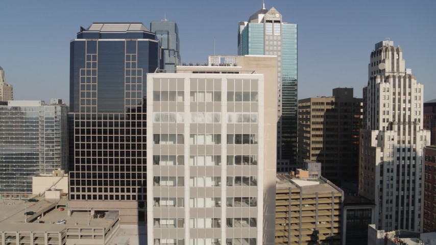 5.7K stock footage aerial video of flying away from a downtown office building at sunrise, Downtown Kansas City, Missouri Aerial Stock Footage   DX0001_001279
