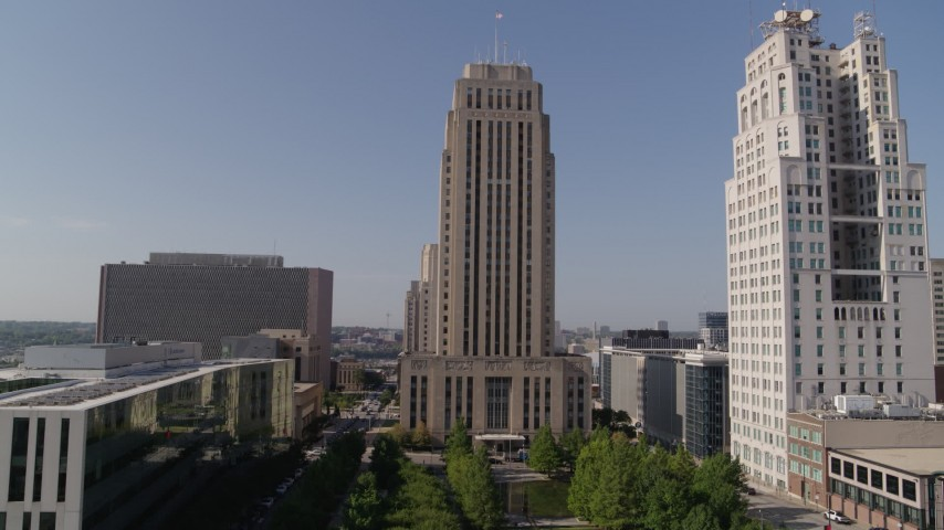 5.7K stock footage aerial video of city hall near a tall skyscraper in Downtown Kansas City, Missouri Aerial Stock Footage | DX0001_001286