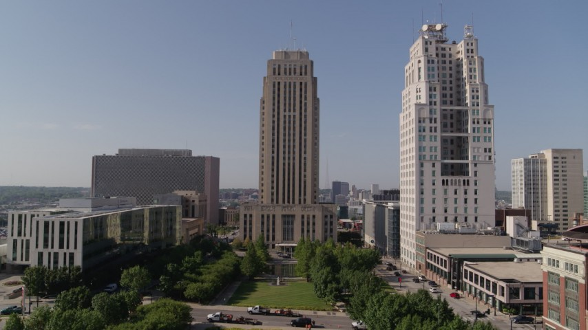 5.7K stock footage aerial video slow approach to city hall near a tall skyscraper in Downtown Kansas City, Missouri Aerial Stock Footage | DX0001_001289