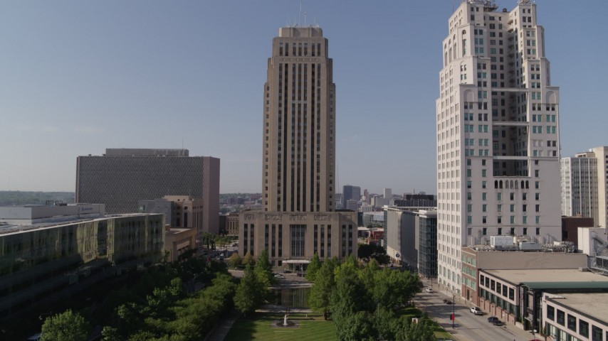 5.7K stock footage aerial video flying toward city hall near a tall skyscraper in Downtown Kansas City, Missouri Aerial Stock Footage | DX0001_001290