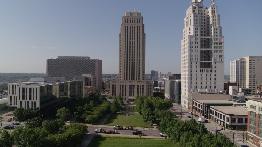 5.7K stock footage aerial video of flying over park to approach city hall in Downtown Kansas City, Missouri Aerial Stock Footage | DX0001_001297
