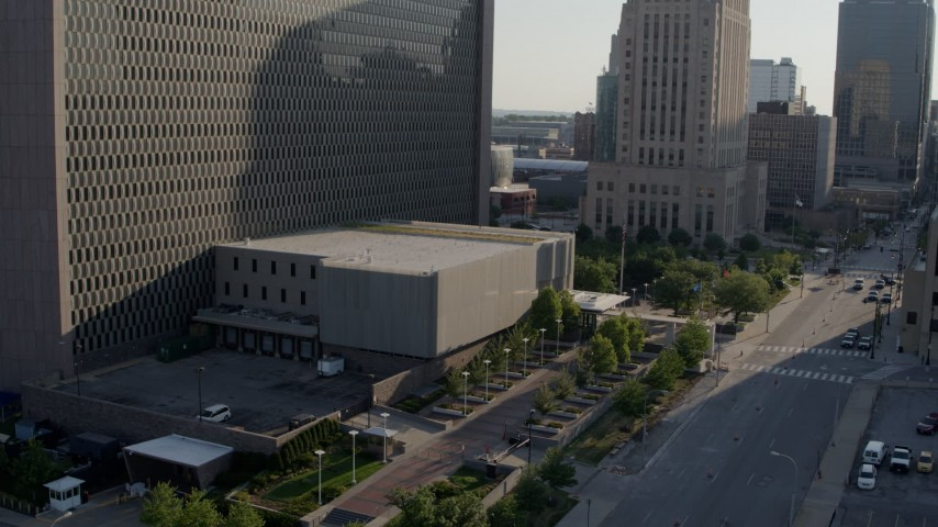 5.7K stock footage aerial video stationary and reverse view of entrance to a government office building in Downtown Kansas City, Missouri Aerial Stock Footage | DX0001_001327