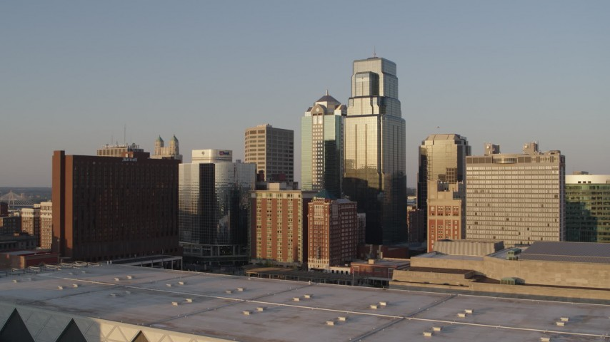 5.7K stock footage aerial video of the setting sun shining on downtown skyscrapers in Downtown Kansas City, Missouri Aerial Stock Footage | DX0001_001348