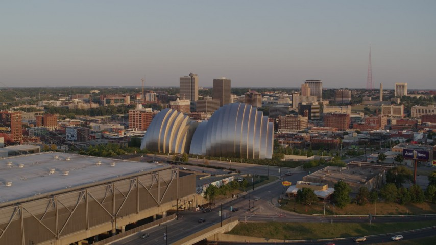 5.7K stock footage aerial video fly away from concert hall, pass convention center at sunset in Downtown Kansas City, Missouri Aerial Stock Footage | DX0001_001350