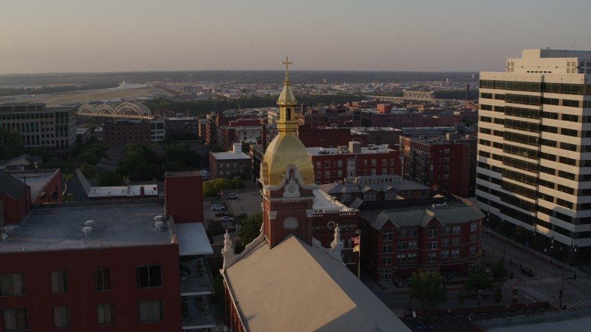 5.7K stock footage aerial video fly away from brick cathedral and office building at sunset in Downtown Kansas City, Missouri Aerial Stock Footage   DX0001_001351