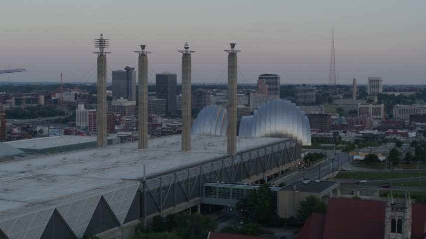 5.7K stock footage aerial video of passing the convention center to approach concert hall at sunset in Downtown Kansas City, Missouri Aerial Stock Footage | DX0001_001358