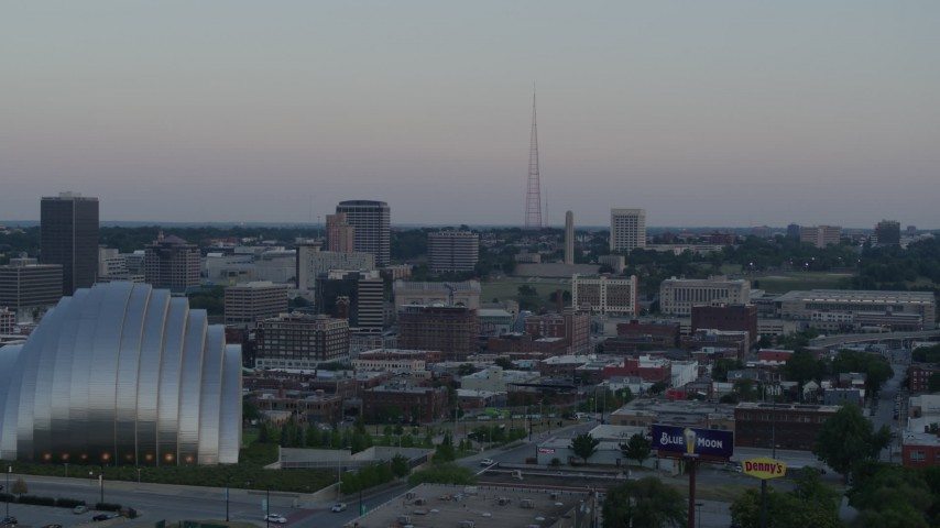 5.7K stock footage aerial video of radio tower, fly past the convention center and concert hall at sunset in Downtown Kansas City, Missouri Aerial Stock Footage | DX0001_001359