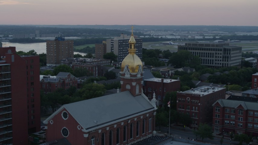 5.7K stock footage aerial video of circling a brick cathedral's steeple at sunset in Downtown Kansas City, Missouri Aerial Stock Footage | DX0001_001361
