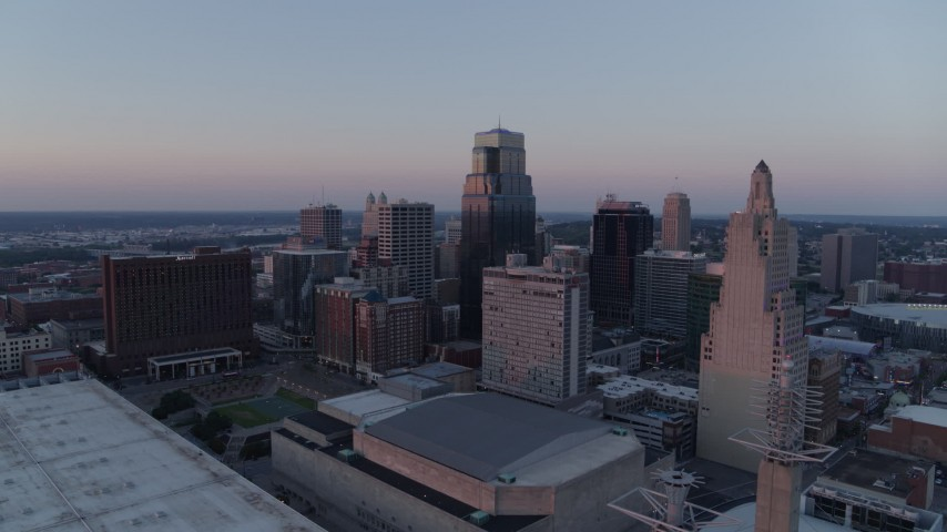 5.7K stock footage aerial video of a stationary view of tall city skyscrapers at sunset in Downtown Kansas City, Missouri Aerial Stock Footage | DX0001_001366