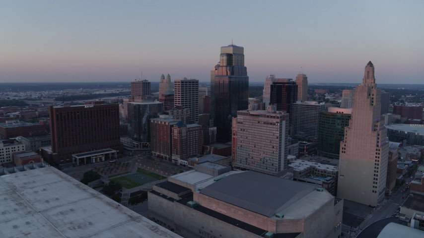 5.7K stock footage aerial video flyby tall city skyscrapers at sunset and descend in Downtown Kansas City, Missouri Aerial Stock Footage | DX0001_001367