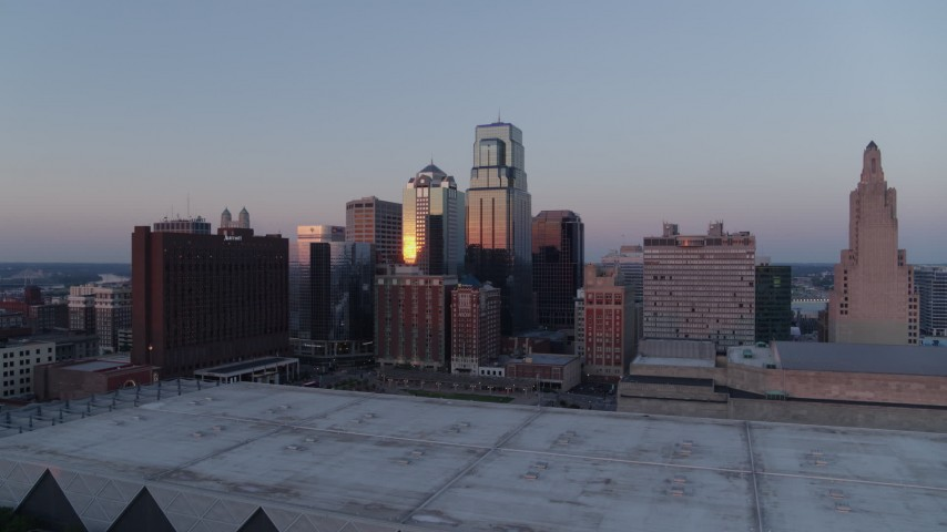 5.7K stock footage aerial video flyby tall downtown skyscrapers near hotel at sunset in Downtown Kansas City, Missouri Aerial Stock Footage | DX0001_001368
