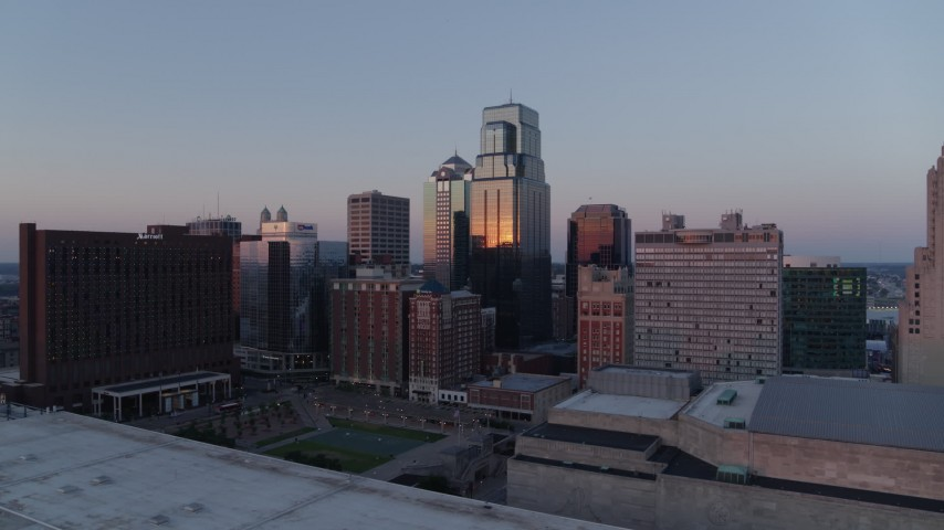 5.7K stock footage aerial video flyby skyscrapers near hotel at sunset and hover for static view in Downtown Kansas City, Missouri Aerial Stock Footage | DX0001_001369