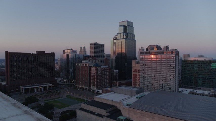 5.7K stock footage aerial video reverse and flyby skyscrapers at sunset in Downtown Kansas City, Missouri Aerial Stock Footage | DX0001_001370