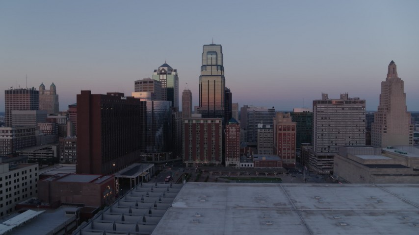 5.7K stock footage aerial video approach skyscrapers at twilight, pause for static view, in Downtown Kansas City, Missouri Aerial Stock Footage | DX0001_001371