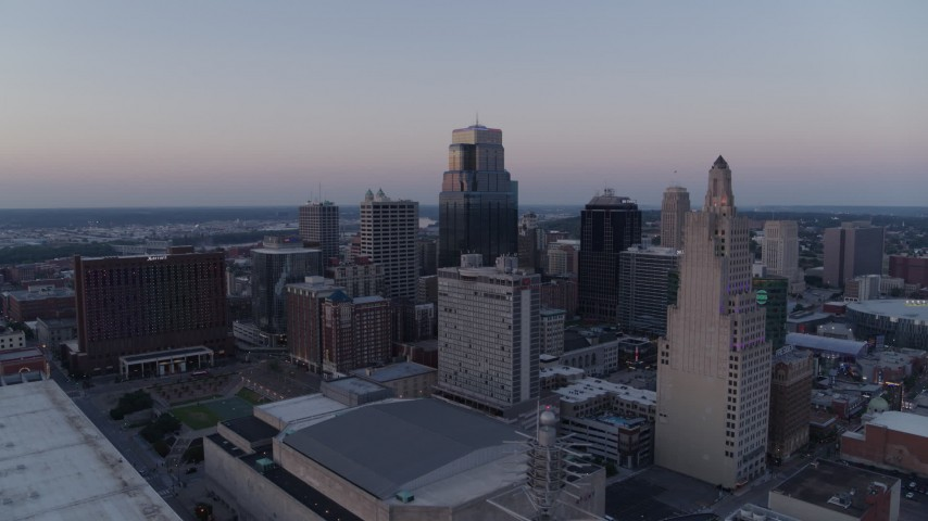 5.7K stock footage aerial video flyby a group of skyscrapers at twilight in Downtown Kansas City, Missouri Aerial Stock Footage | DX0001_001374