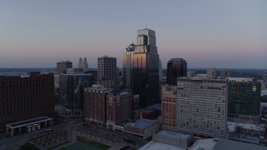 5.7K stock footage aerial video of flying by a group of skyscrapers at twilight in Downtown Kansas City, Missouri Aerial Stock Footage | DX0001_001379