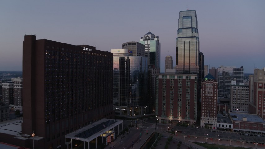 5.7K stock footage aerial video of flying away from hotel and skyscrapers at twilight in Downtown Kansas City, Missouri Aerial Stock Footage | DX0001_001380