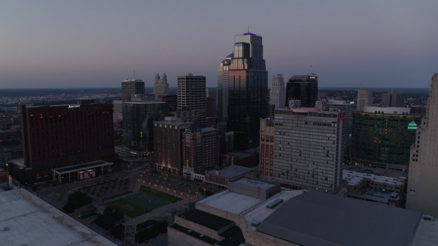 5.7K stock footage aerial video of flying by tall city skyscrapers at twilight in Downtown Kansas City, Missouri Aerial Stock Footage | DX0001_001381