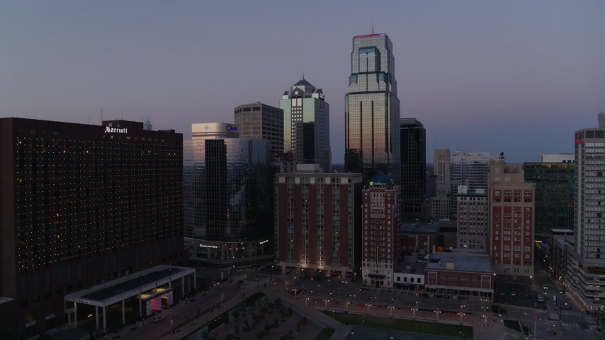 5.7K stock footage aerial video of a downtown hotel and tall city skyscrapers at twilight in Downtown Kansas City, Missouri Aerial Stock Footage | DX0001_001382