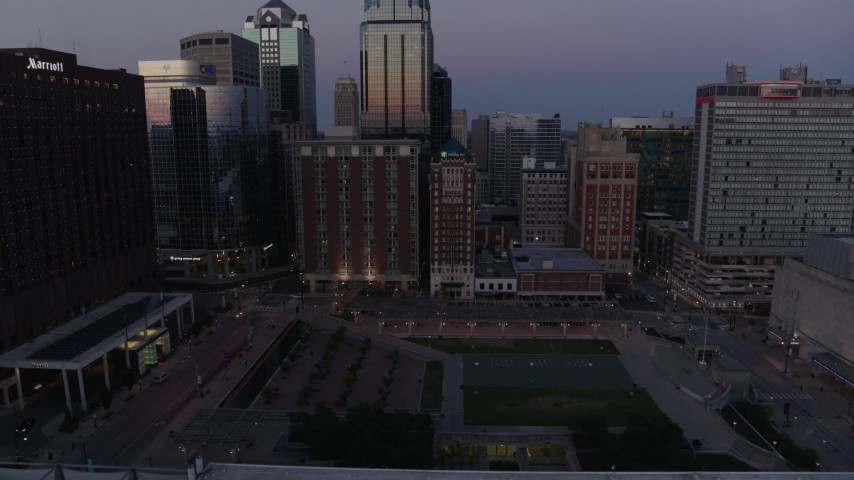5.7K stock footage aerial video ascend from near park for a view of city skyscrapers at twilight in Downtown Kansas City, Missouri Aerial Stock Footage | DX0001_001383