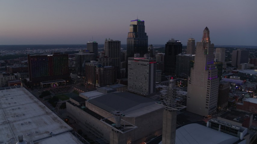 5.7K stock footage aerial video of city skyscrapers lit up for the evening at twilight in Downtown Kansas City, Missouri Aerial Stock Footage | DX0001_001384
