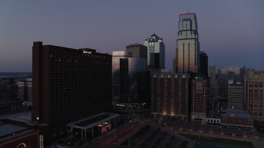 5.7K stock footage aerial video of flying by and away from hotel and skyscrapers at twilight in Downtown Kansas City, Missouri Aerial Stock Footage | DX0001_001387