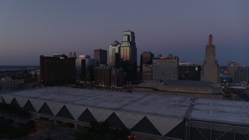 5.7K stock footage aerial video pass and approach downtown hotel and skyscrapers at twilight in Downtown Kansas City, Missouri Aerial Stock Footage   DX0001_001389