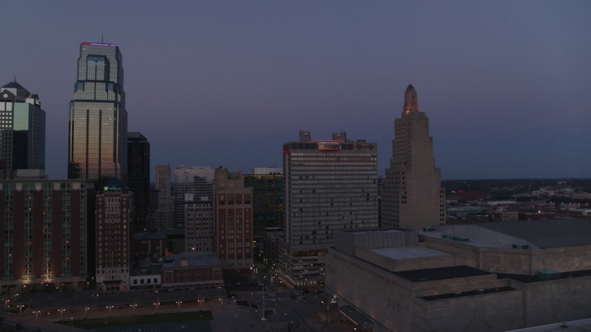 5.7K stock footage aerial video of a downtown hotel and skyscrapers at twilight in Downtown Kansas City, Missouri Aerial Stock Footage | DX0001_001390