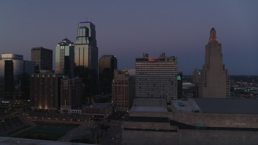 5.7K stock footage aerial video flyby a downtown hotel and skyscrapers at twilight in Downtown Kansas City, Missouri Aerial Stock Footage | DX0001_001391