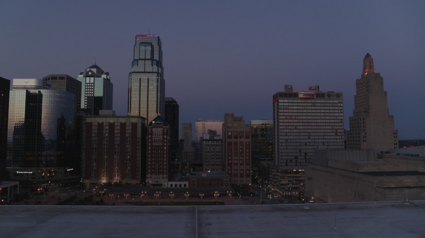 5.7K stock footage aerial video ascend with a view of a hotel and skyscrapers at twilight in Downtown Kansas City, Missouri Aerial Stock Footage | DX0001_001393